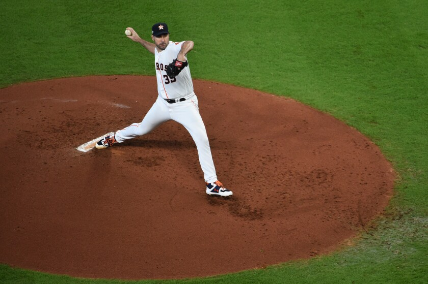 Houston Astros starter Justin Verlander delivers against the Tampa Bay Rays in Game 1 of the American League Division Series on Friday.