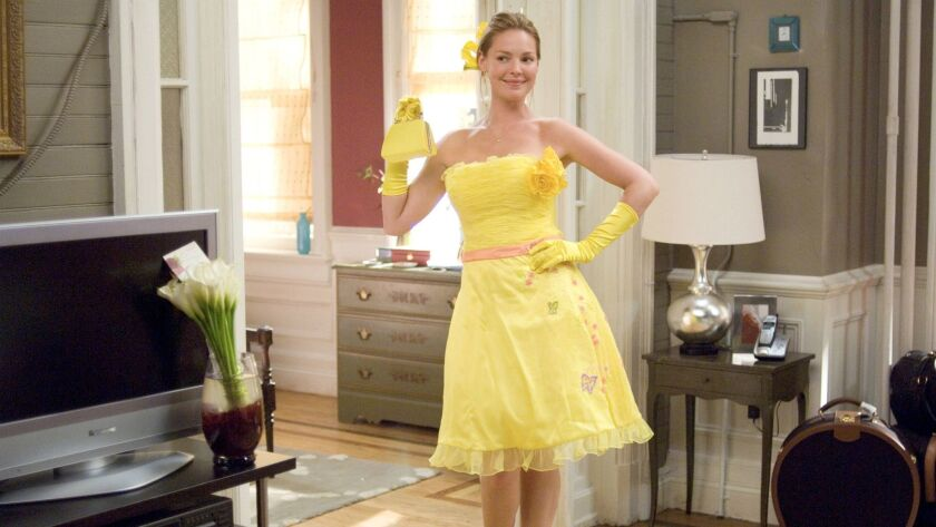 Jane (Katherine Heigl) glows in the her bridesmaid dress in the 2008 movie 27 Dresses .Photographs b