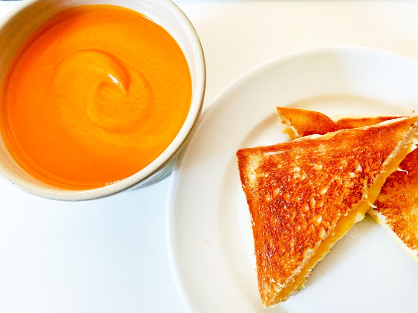 Homemade tomato soup and a grilled cheese sandwich