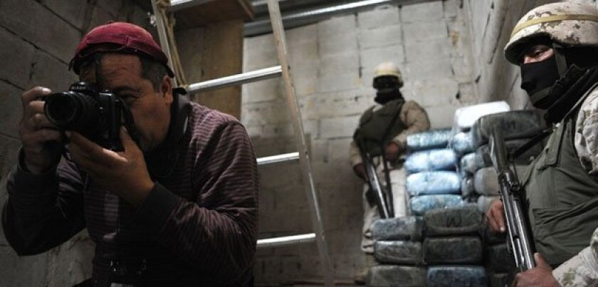 A photographer covers the story of a drug tunnel found in Tijuana. Nowadays, there are fewer reporters covering these type of stories due to threats and violence. David Maung/SanDiegoRed
