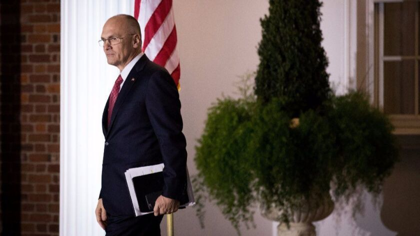 Andrew Puzder, chief executive of CKE Restaurants, exits after his meeting with president-elect Donald Trump at Trump International Golf Club, November 19, 2016 in Bedminster Township, New Jersey