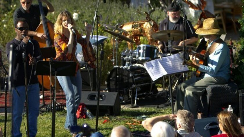 To avoid wet weather, the 34th annual free outdoor Christmas Eve concert is being moved to the Encinitas Community Center. The all-star concert, led by top jazz guitarist Peter Sprague, will begin at 1 p.m.