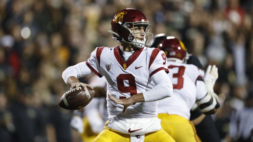 USC quarterback Kedon Slovis looks to throw in the second half against Colorado on Friday in Boulder, Colo. USC won 35-31.