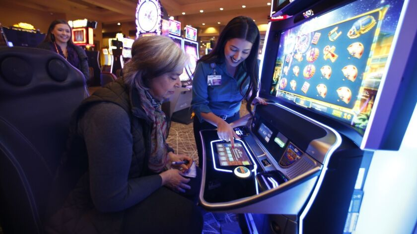 Getting a tutorial on how to play the Sphinx 4D from Alexandria Santana at Sycuan Casino. Think of it as virtual reality gambling without the geeky glasses.