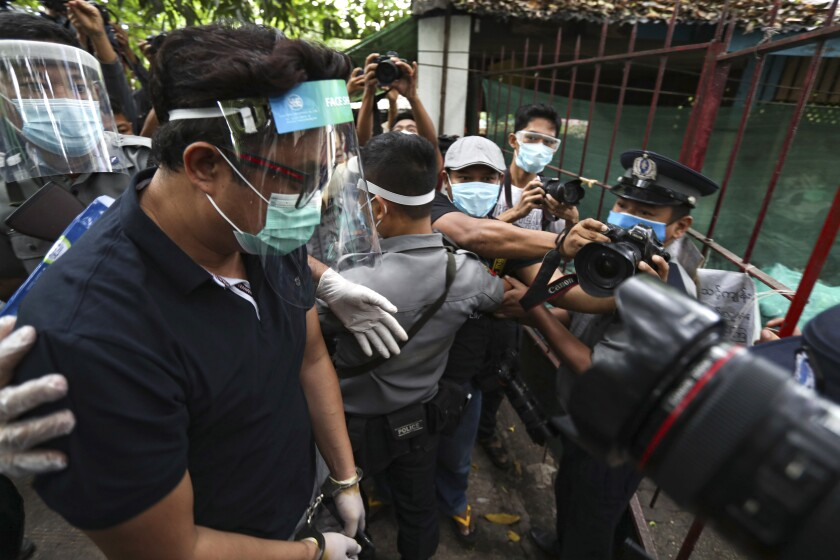 Canadian pastor David Lah is escorted to a court hearing in Yangon, Myanmar, on Wednesday.