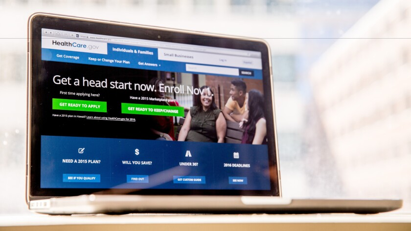The HealthCare.gov website is displayed on a laptop in October of 2015.