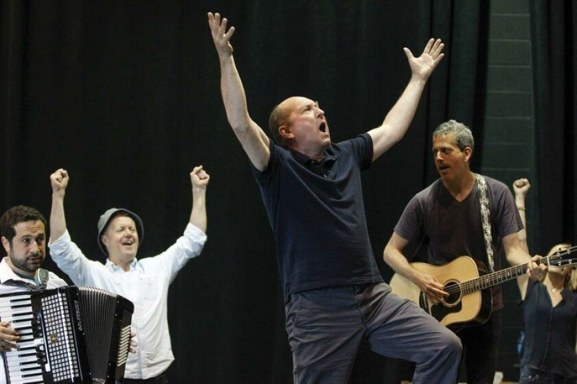 Joel Hatch (center) and fellow cast members rehearse a number from La Jolla Playhouse's 'Come From Away.'