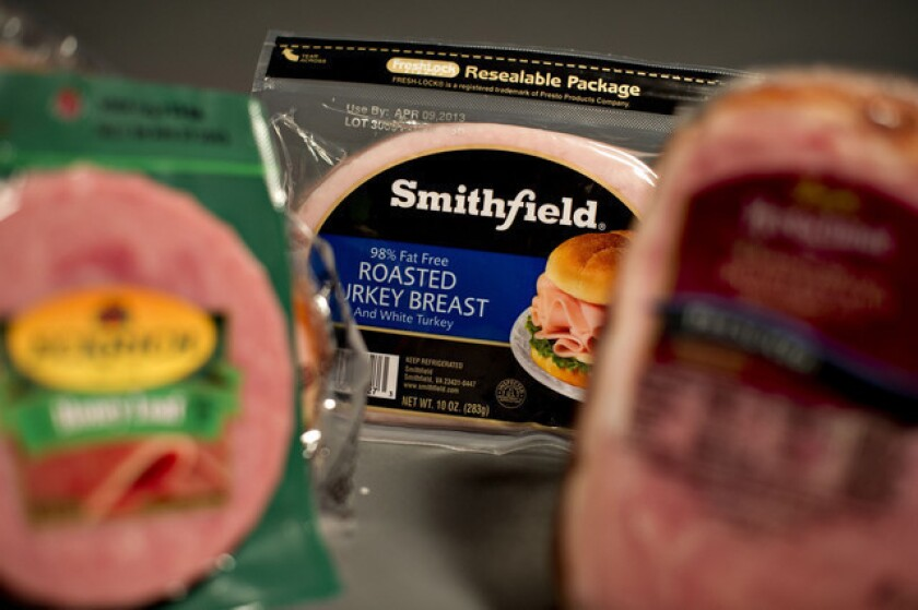 Chinese meat company Shuanghui buys pork producer Smithfield for $7.1 billion, including debt.