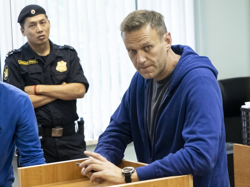 Alexei Navalny, Russia's most prominent opposition figure, who has been detained by police and charged with unlawfully organizing a public gathering, sits in a courtroom in Moscow on July 24, 2019.