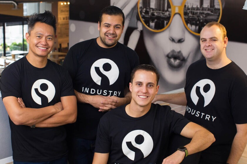 Industry co-founders (from left) Errol Asuncion II, Varun Villait, Cody Barbo, and Matthew Cecil pose for photos on Friday in downtown San Diego, California. Their company is like LinkedIn for the restaurant industry. (Eduardo Contreras/U-T)