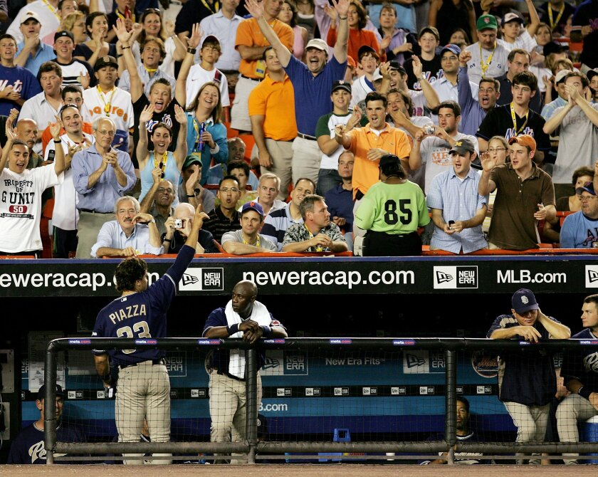 Padres' Mike Piazza acknowledges the crowd after hitting a solo home run against the Mets on August 9, 2006 at Shea Stadium.