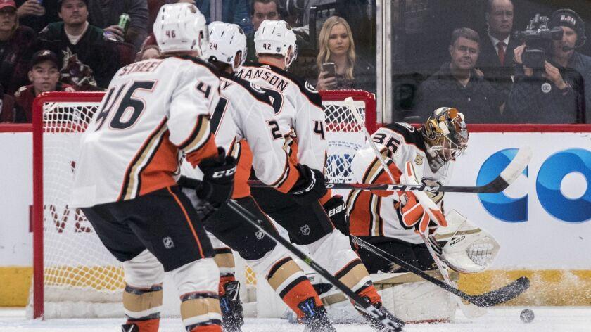 Anaheim Ducks goalie John Gibson (36) blocks a shot bu the Arizona Coyotes as teammates Ben Street (