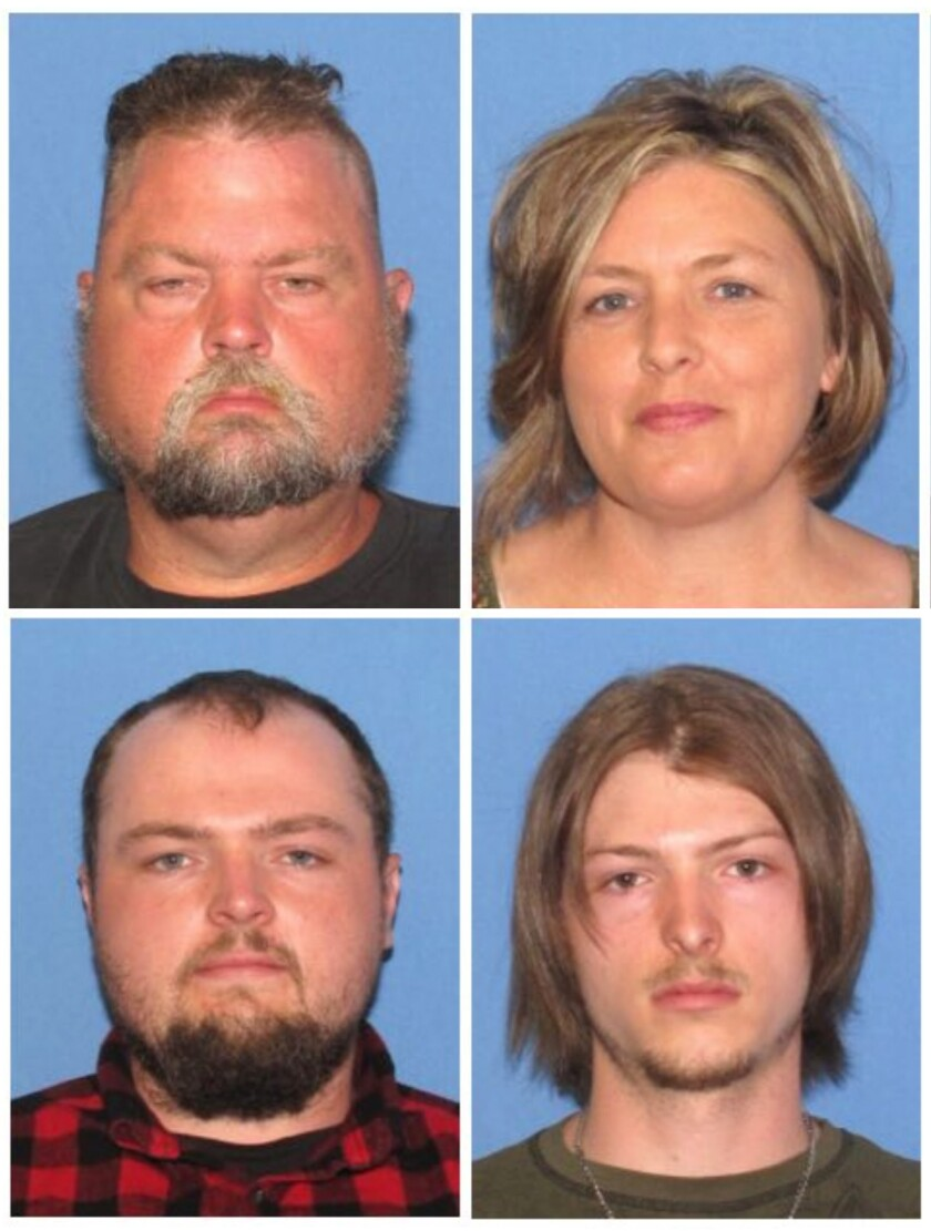 """FILE - These undated file images released by the Ohio Attorney General's office, show, top row from left, George """"Billy"""" Wagner III and Angela Wagner, and bottom row from left, George Wagner IV and Edward """"Jake"""" Wagner. The four members of the Wagner family were charged in the 2016 slayings of eight members of the Rhoden family in rural Ohio. Tony Rhoden Sr., a man who lost several relatives in the mass slaying, has filed a wrongful death lawsuit against the four suspects in the killings. (Ohio Attorney General's office via AP, File)"""