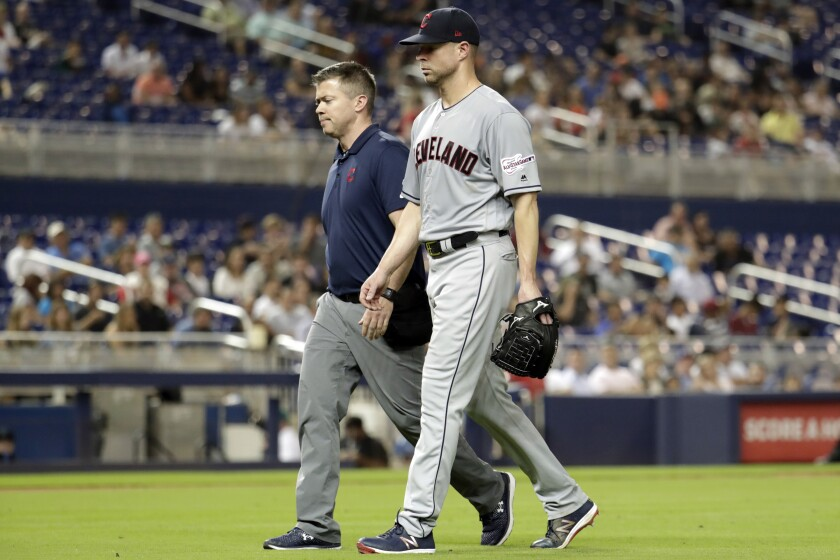 FILE - In this May 1, 2019, file photo, Cleveland Indians starting pitcher Corey Kluber, right, leaves during the fifth inning of the team's baseball game against the Miami Marlins, in Miami. For the first time since 2015, baseball's postseason will go on without the Indians. (AP Photo/Lynne Sladky, File)