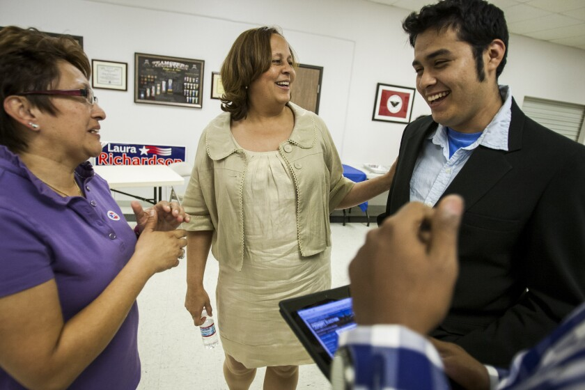 Christopher Castillo with former Democratic Rep. Laura Richardson, center, at a primary election night party in 2012. Richardson lost in the general election to Janice Hahn.