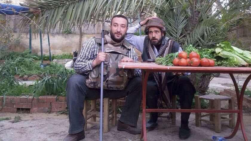 Ahmad Khatab, left, and Shaher Almuneera, members of the Syrian volunteer theater troupe Saraqeb You