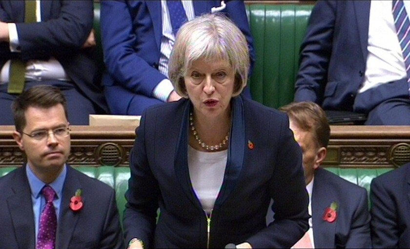 """British Home Secretary Theresa May speaks in the House of Commons in London on Nov. 4. """"Technology has moved on. The law hasn't,"""" May said. """"We need to update the law so that our law-enforcement and security agencies have the powers they need to continue to keep us safe."""""""