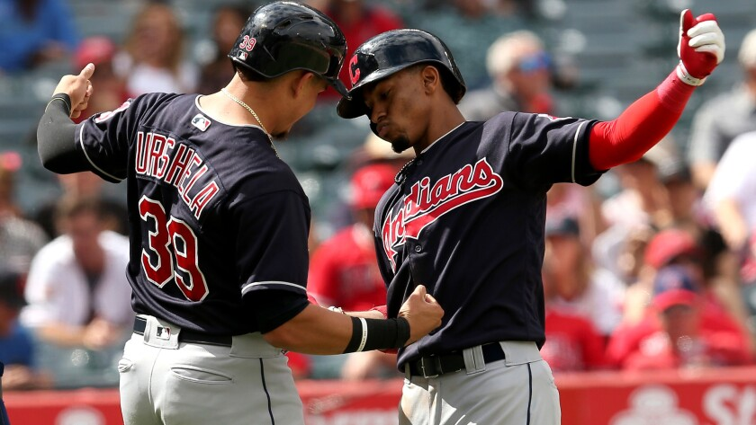Indians shortstop Francisco Lindor, right, celebrates his three-run homer with teammate Giovanny Urs