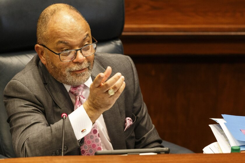 In a Wednesday, April 17, 2019 photo, Hamilton County Attorney Rheubin Taylor speaks during a County Commission meeting in the County Commission assembly room at the Hamilton County Courthouse in Chattanooga, Tenn. Officials in Hamilton County have destroyed public records that were being sought by a reporter from a newspaper in the state, according to the reporter and managers at the newspaper. (C.B. Schmelter/Chattanooga Times Free Press via AP)