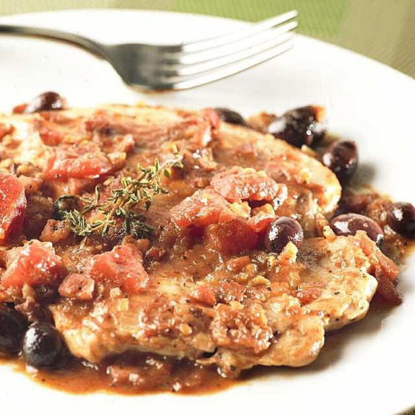 Basque-style chicken with pancetta, nicoise olives, and thyme sprigs.