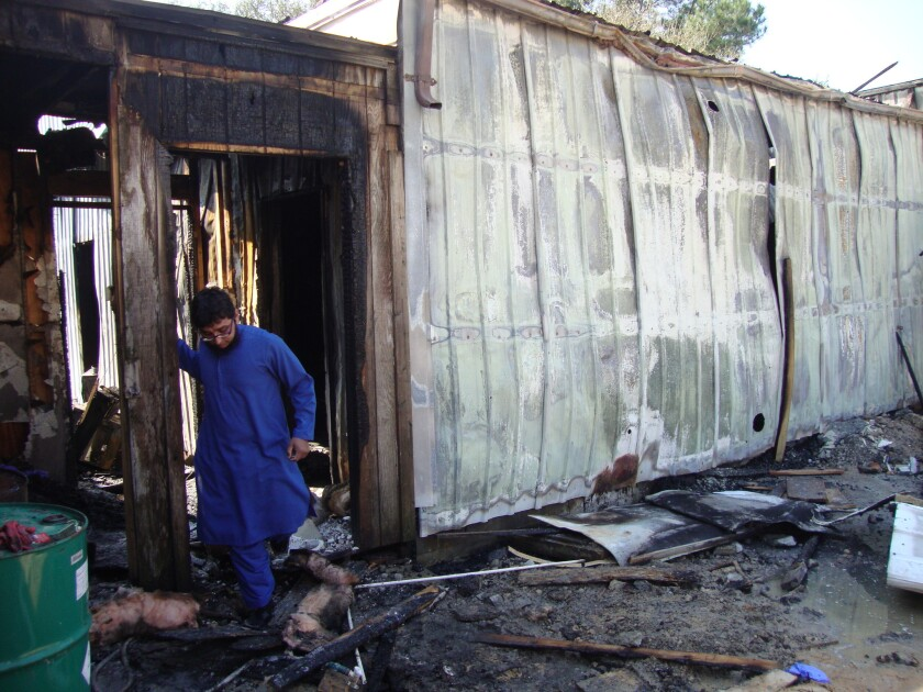 Ahsan Zahid, an assistant imam, inspects fire damage at the Quba Islamic Institute in Houston.