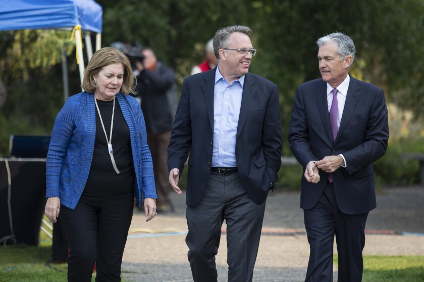 Fed officials Esther George,  John Williams and Jerome Powell