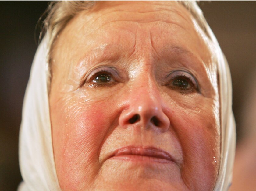 """FILE - In this July 8, 2005, file photo, Nora Cortinas, one of the leaders of the human rights group Mothers of Plaza de Mayo, cries as she attends a news conference in Buenos Aires, Argentina. Cortinas told a local radio Friday, Feb. 19, 2016, that """"she's not amused"""" that the upcoming visit by US"""