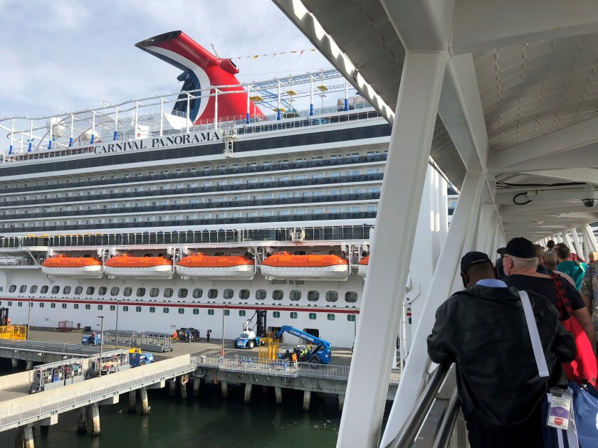 Travelers board the Panorama on Dec. 11 for its inaugural voyage out of Long Beach.