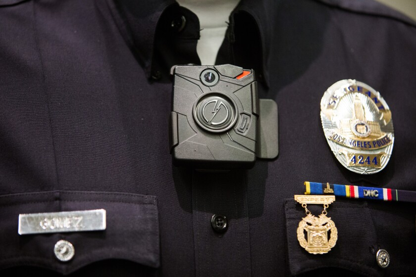 Los Angeles police Sgt. Dan Gomez, of the LAPD Tactical Technology Section, wears a body camera during the December press conference in which Mayor Eric Garcetti announced that the city would purchase 7,000 of the devices for police officers.