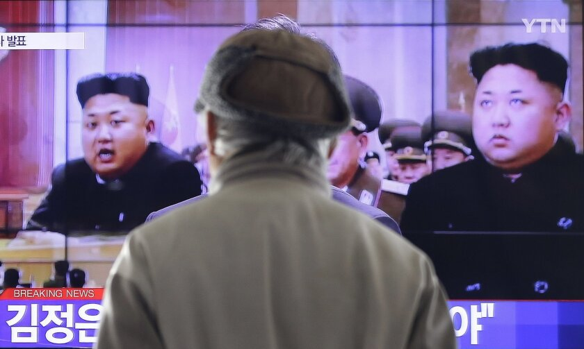 A man watches a TV news program showing North Korean leader Kim Jong-Un, at the Seoul Railway Station in Seoul, South Korea, Thursday, Jan. 1, 2015. Kim, in a nationally televised New Year's Day speech, says he is open to a summit with his South Korean counterpart. (AP Photo/Ahn Young-joon)