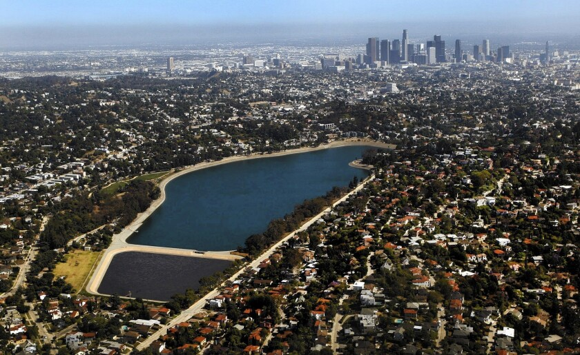 A 2012 aerial view of Silver Lake Reservoir, with the smaller Ivanhoe Reservoir in the foreground and downtown Los Angeles in the distance. The prospect of re-imagining the L.A. landmark has sparked a rush of ideas and enthusiasm.