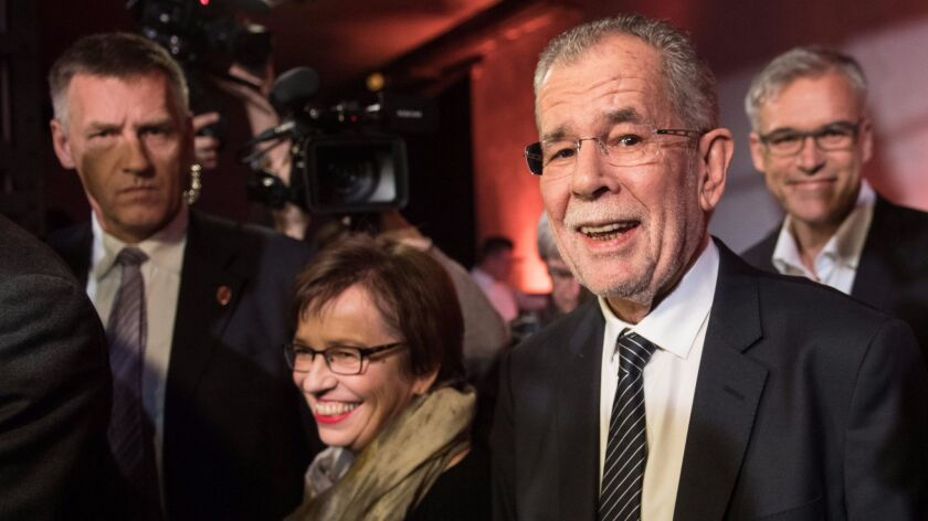 Austrian presidential candidate and former head of the Austrian Green Party Alexander Van der Bellen, right, and his wife, Doris Schmidauer, arrive Dec. 2 at an election rally in Vienna.