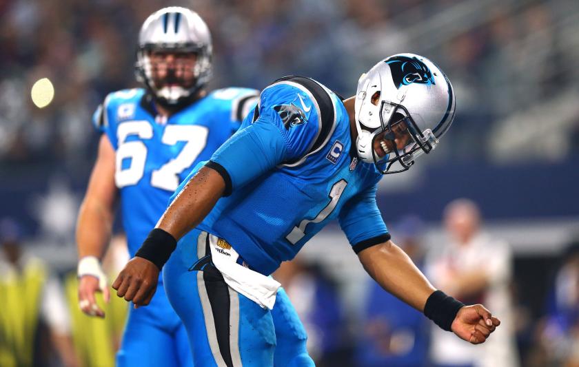 Carolina Panthers quarterback Cam Newton celebrates in front of center Ryan Kalil after scoring a touchdown.