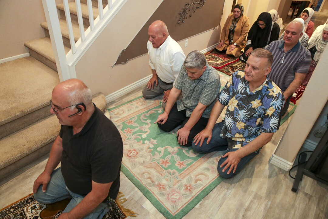 The Fejleh family offer the Maghrib prayer after breaking their Ramadan fast at home in Montclair.