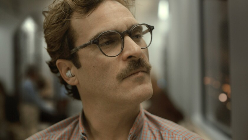 Joaquin Phoenix as Theodore takes a moment to think.