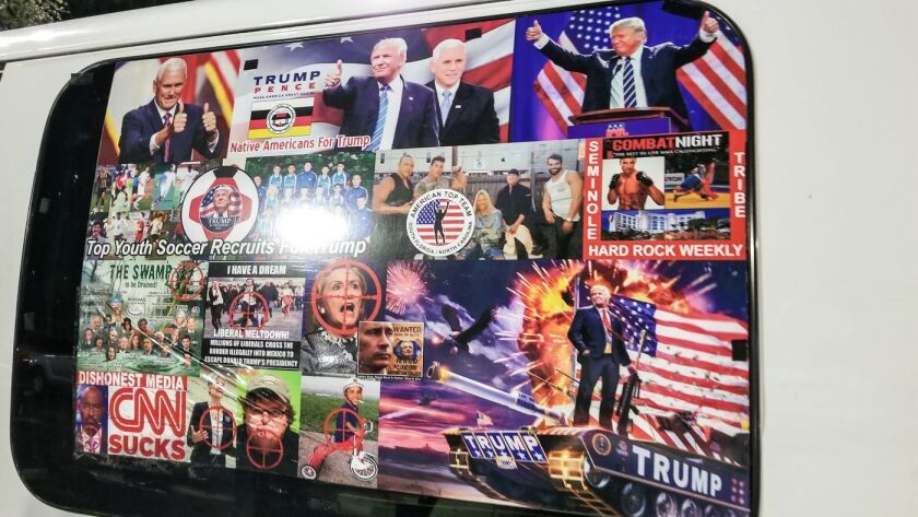 The side window of Cesar Sayoc's lived in van with plastered images of Democrats in rifle crosshairs.