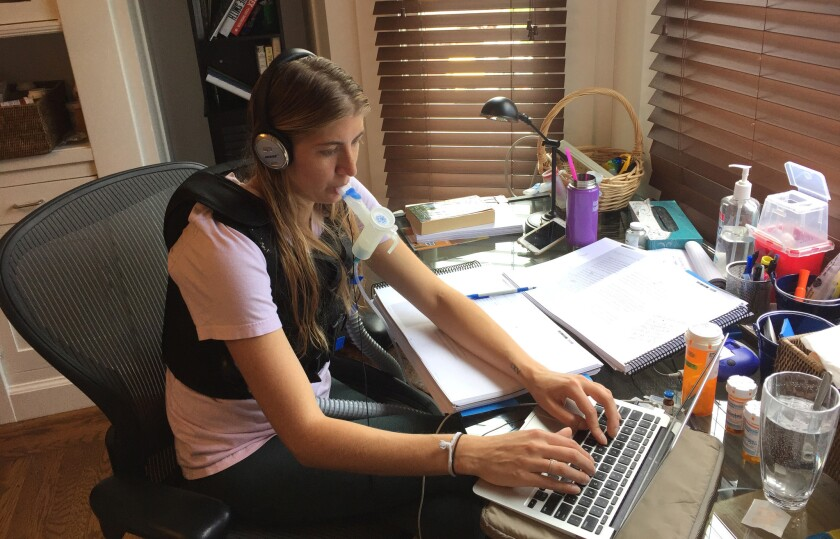 Mallory Smith, in her San Francisco apartment writing a book. Smith died in November 2017 at age 25.