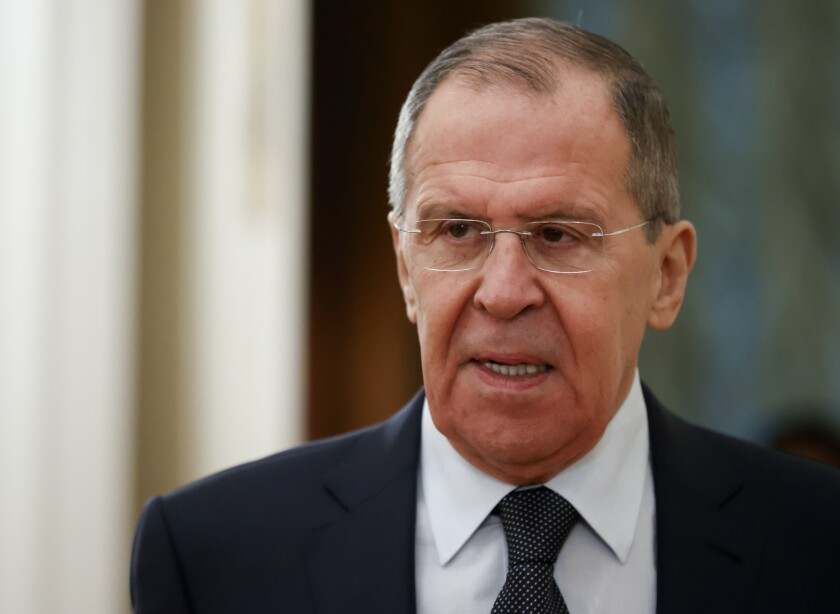 FILE - In this Monday, Feb. 3, 2020 file photo, Russian Foreign Minister Sergey Lavrov arrives to attend a meeting in Moscow, Russia. Russia's top diplomat has on Friday, July 10 dismissed U.S. intelligence information alleging that Moscow has offered bounties to the Taliban for killing American soldiers in Afghanistan as part of the U.S. political infighting. (AP Photo/Alexander Zemlianichenko, File)