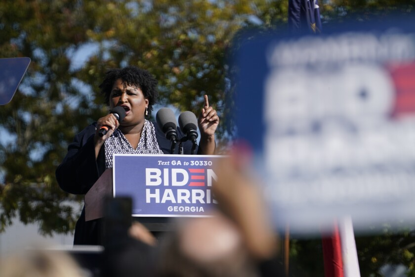 In this Nov. 2, 2020, photo, Stacey Abrams speaks to supporters as they wait for former President Barack Obama to arrive and speak at a rally as he campaigns for Democratic presidential candidate former Vice President Joe Biden, at Turner Field in Atlanta. (AP Photo/Brynn Anderson)