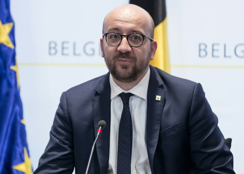 Belgian Prime Minister Charles Michel participates in a media conference at the Belgian prime ministers office in Brussels on Friday, March 18, 2016. Two French police officials have told The Associated Press that Salah Abdeslam, the main fugitive from Islamic extremist attacks in Paris in November, has been arrested in Belgium's capital after four months at large. He was arrested Friday in a major police operation in the Brussels neighborhood of Molenbeek. (AP Photo/Thierry Monasse)