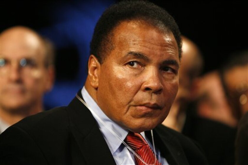 In this Sept. 24, 2008, file photo, Former boxing heavyweight champion of the world Muhammad Ali watches from the audience during the opening plenary of the Clinton Global Initiative annual meeting in New York. (AP Photo/Jason DeCrow, file)