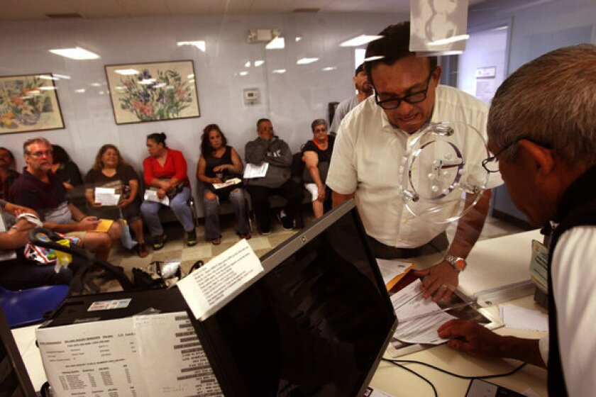A patient checks in at L.A. County-USC Medical Center in Los Angeles last month.