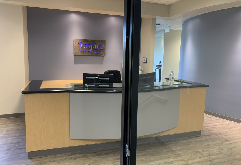 The front entrance of an Inspire office located on the second floor at 14261 Danielson St. in Poway looks quiet on a Tuesday evening. This is where the Pacific Coast Academy Inspire charter school holds its board meetings, according to its website.