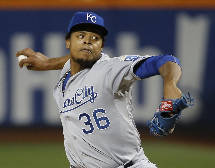 FILE - In this Nov. 1, 2015, file photo, Kansas City Royals pitcher Edinson Volquez throws during the first inning of Game 5 of the Major League Baseball World Series in New York. Volquez will start the Kansas City Royals' opener April 3 against the New York Mets in a rematch of the World Series Game 5, manager Ned Yost announced Saturday, March 26, 2016. (AP Photo/Matt Slocum, File)