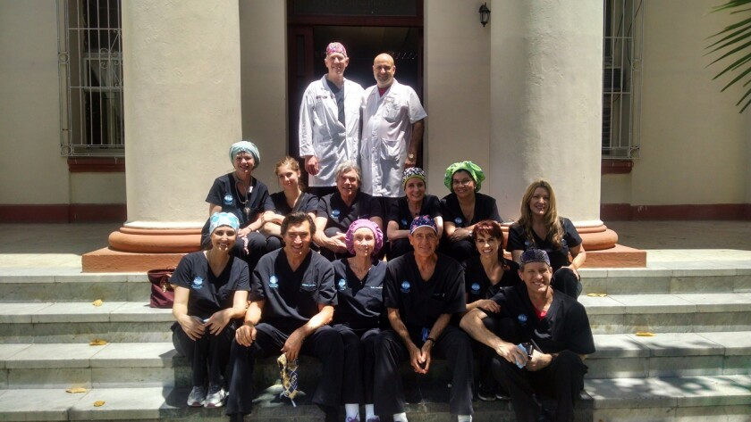 Dr. Larry Nichter and his traveling team of doctors, nurses and coordinators pose for a photo in Cuba.