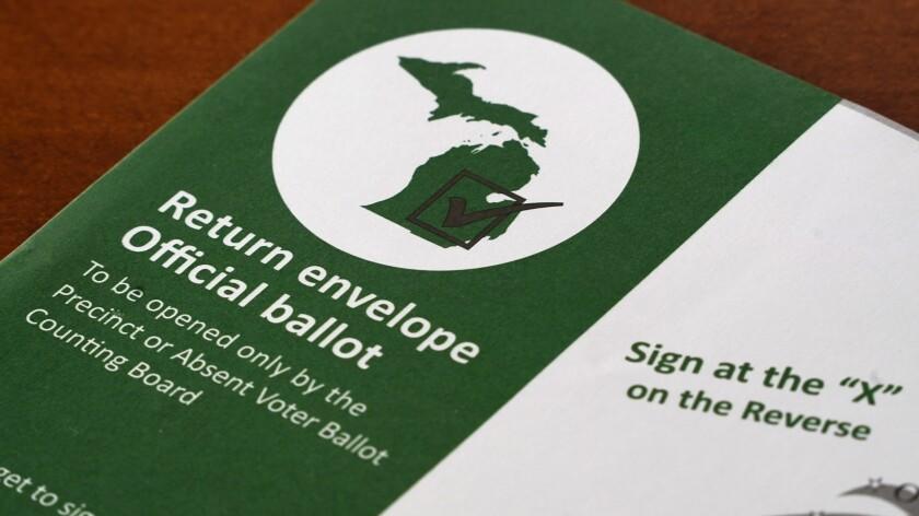A Michigan absentee ballot return envelope