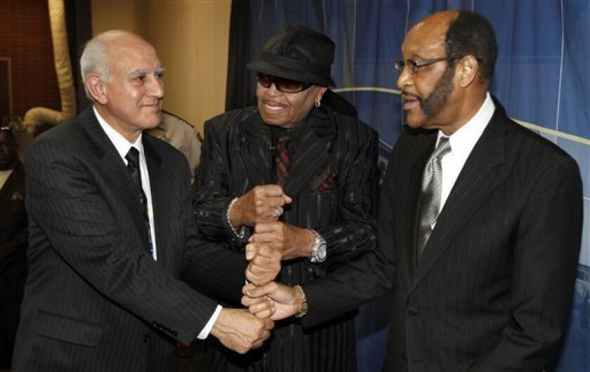 From left, Simon Sahouri, President of the Jackson Family Foundation, Joe Jackson, father of Michael Jackson, and Rudy Clay, Mayor of Gary, Ind., pose for a photograph at a press conference on Wednesday, June 2, 2010, in Gary, Ind. Work could begin next year on a $300 million museum and arts center dedicated to Michael Jackson in his hometown, his father and Gary officials announced Wednesday. (AP Photo/John Smierciak)