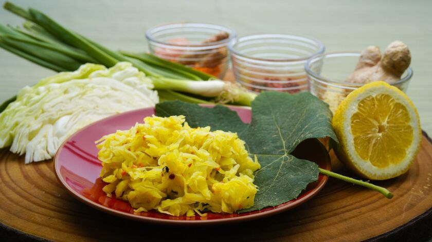 Curt Wittenberg serves Dreamy Golden Kraut over a large grape leaf.