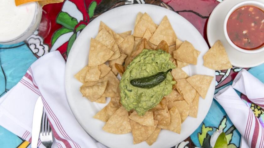LOS ANGELES, CALIFORNIA - May 18, 2019: Fresh homemade guacamole, served in a crispy flour tortilla