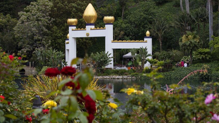 The Golden Lotus Archway can be seen from across the lake in the Meditation Gardens at the Lake Shrine Self Realization Fellowship silence retreat in Pacific Palisades, Calif.